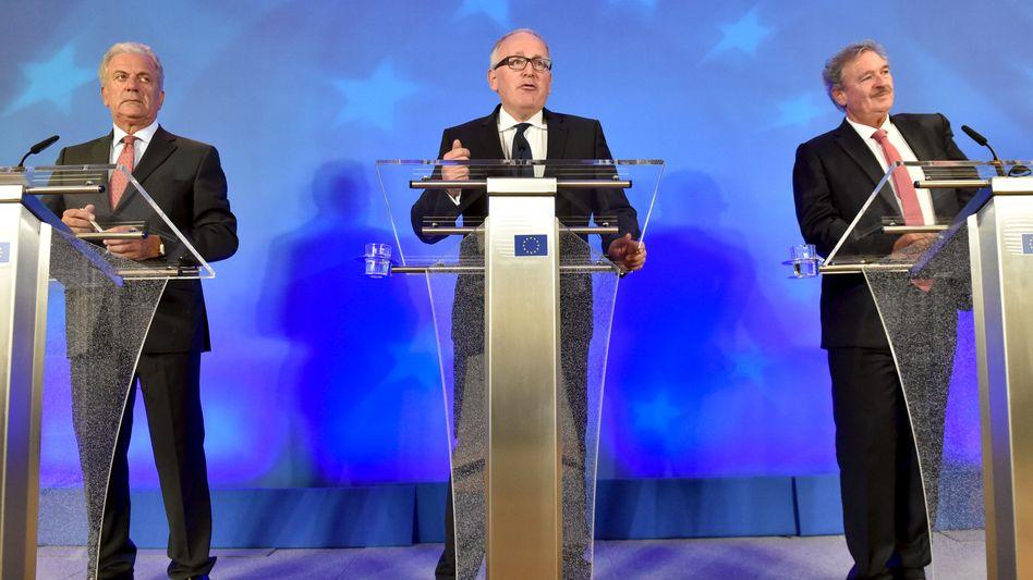 EU-Funktionäre Avramopoulos, Timmermans und Asselborn: Ratlose Herren Europas