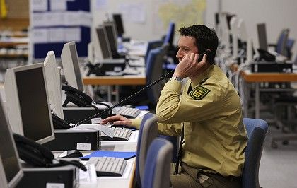 A German police officer in the operation center for the NATO summit.