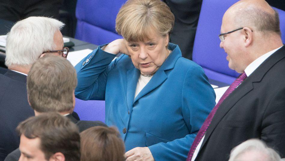 Steinmeier, Merkel, Altmaier im Bundestag