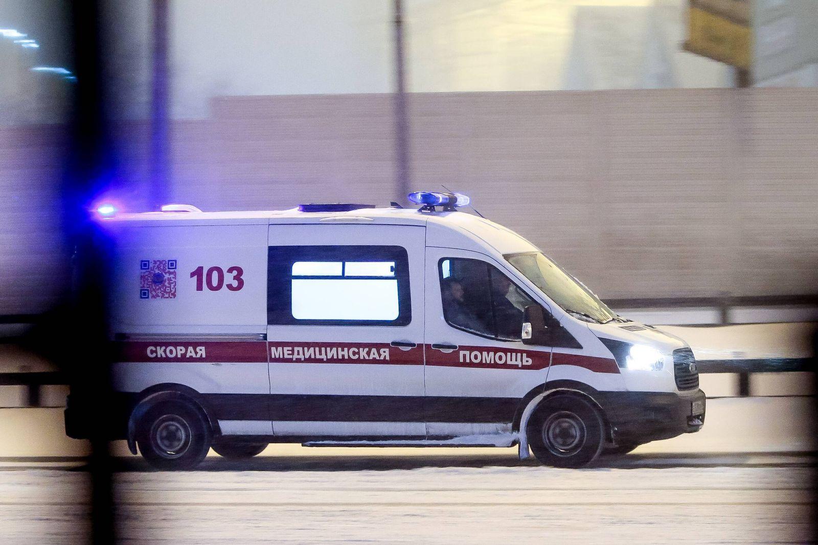 Heavy snowfall in Moscow, Russia. Car in traffic heacy snowfall. Ambulance DmitryxGolubovich