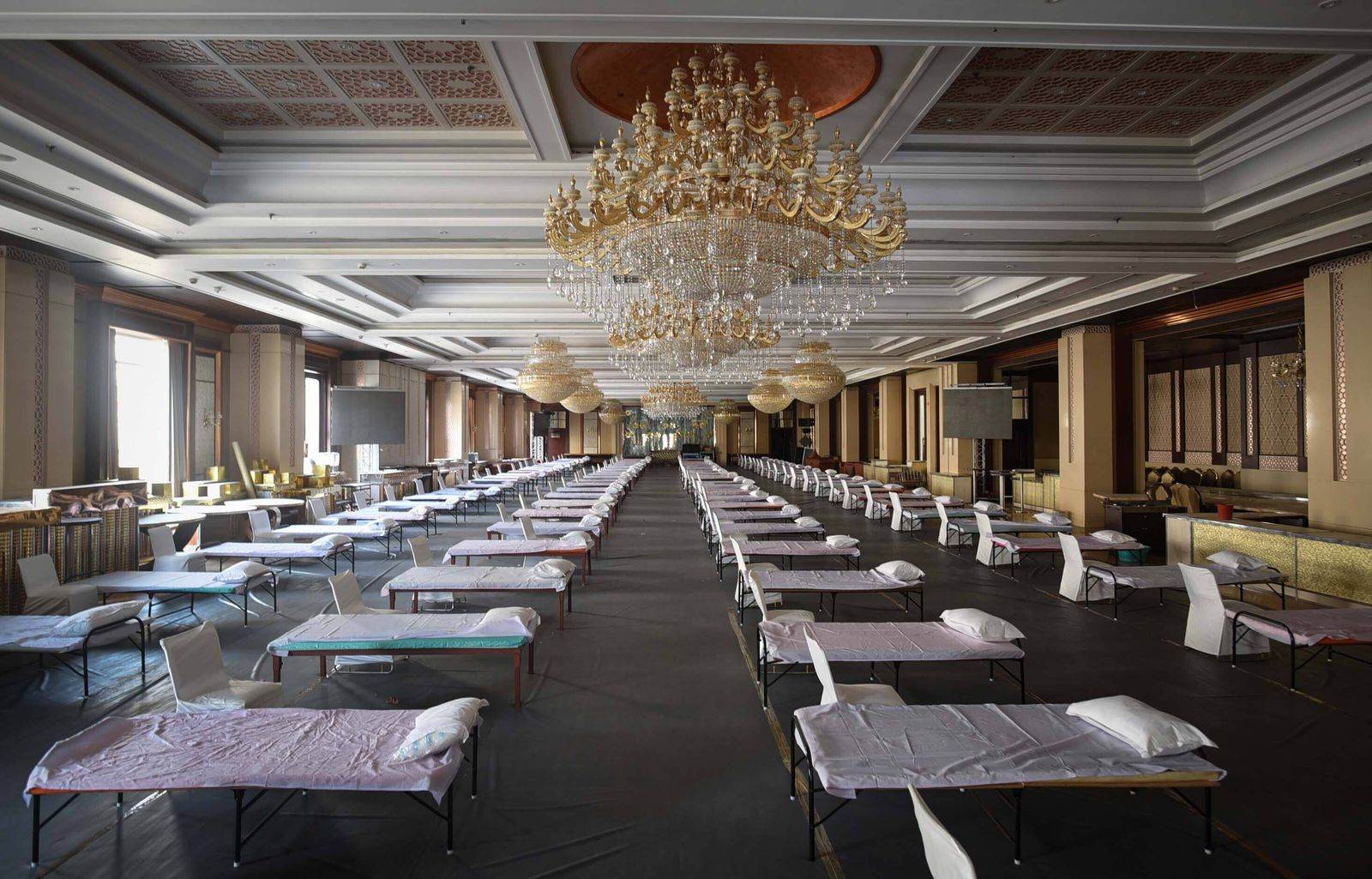 NEW DELHI, INDIA - JULY 5: Beds placed in the hall at The Heritage Grand Banquet which has been requisitioned for use a