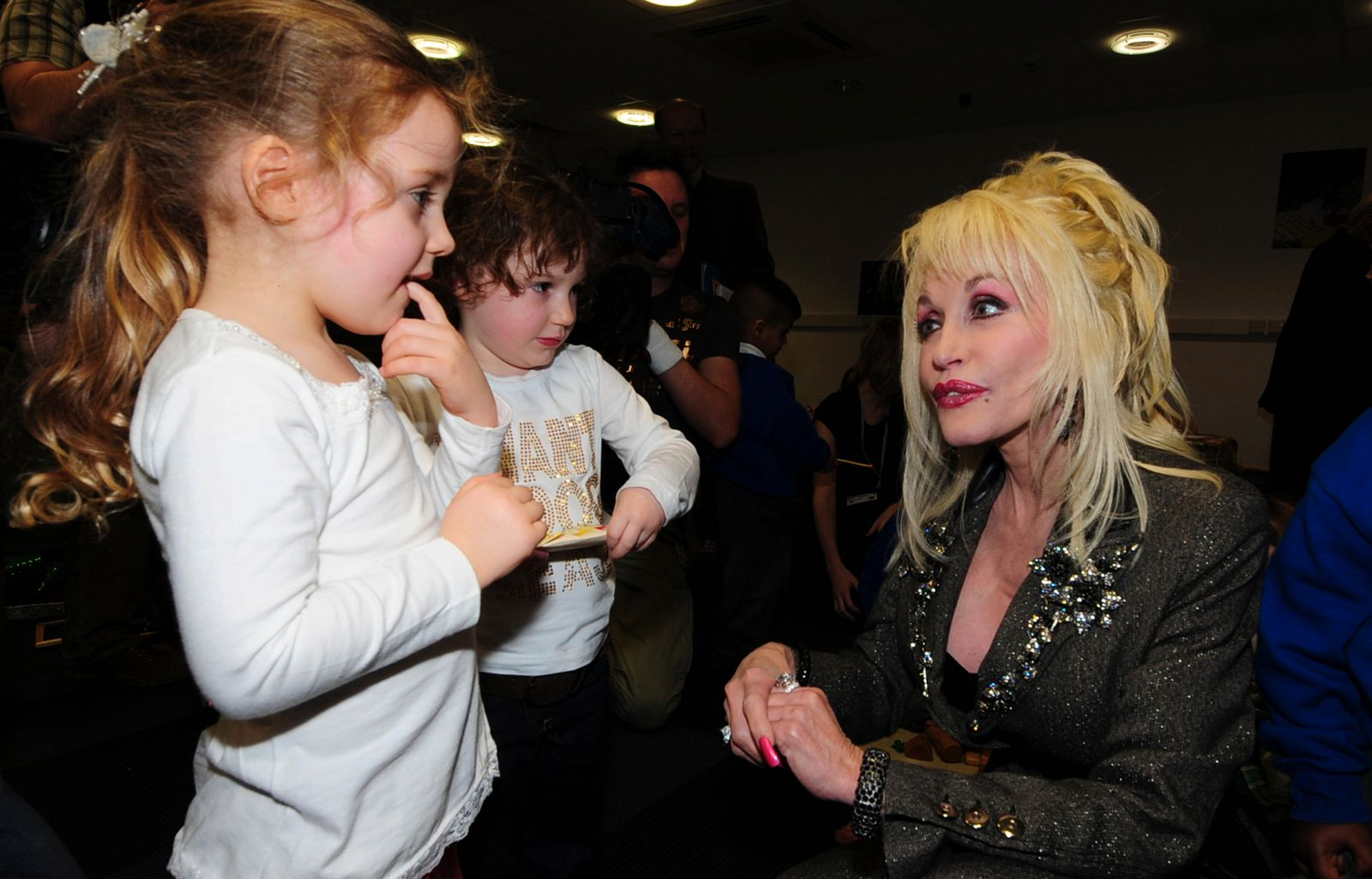 US singer Parton speaks to children at the launch of her Imagination Library launch in the Magna Centre in Sheffield