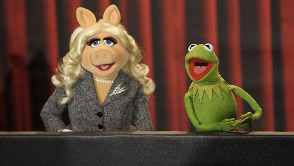 """""""Wir haben keine Probleme mit der Ölindustrie"""", versichern Miss Piggy und Kermit."""