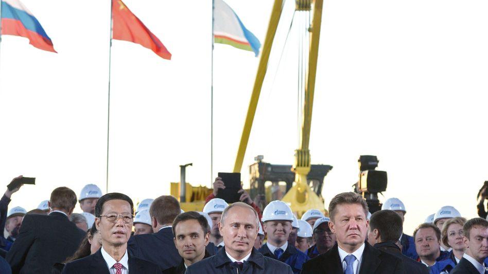 """Chinas Vizepremier, Russlands Präsident und der Gazprom-Chef (v.l.): Das """"größte Bauprojekt der Welt"""" gestartet"""
