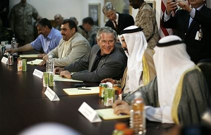 U.S. President George W. Bush meets with Iraqi tribal leaders during his unannounced visit to Al-Asad air base in Anbar province on Monday, in what some see as a new, decentralized strategy.