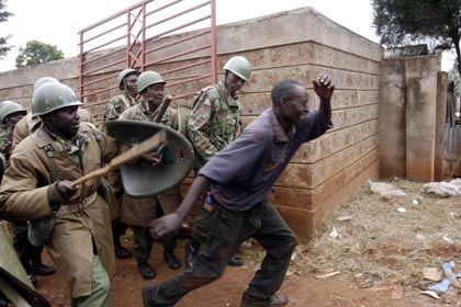 An opposition supporter runs from police in Kibera, a slum which is an opposition stronghold in Nairobi on Monday.