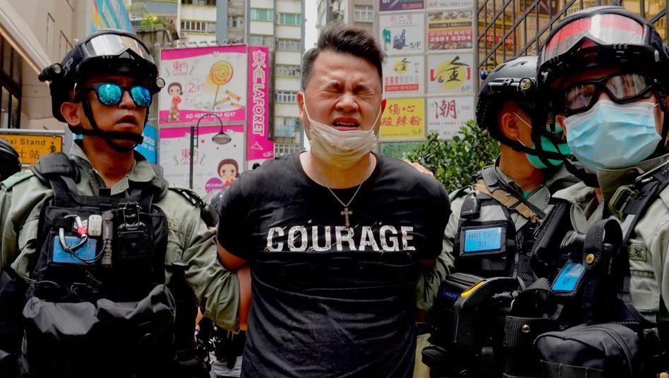 Polizisten, Demonstrant in Hongkong