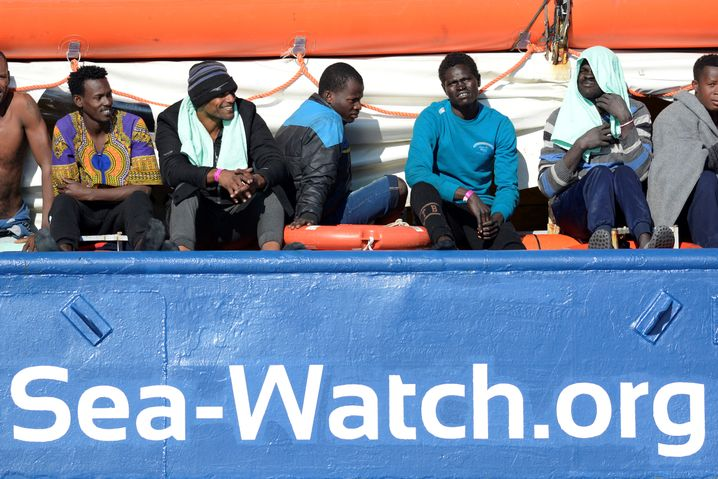 Migrants resting on board the Sea Watch 3 off the coast of Italy