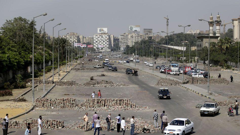 Barrikaden in Kairo: Muslimbrüder kündigen neue Proteste an