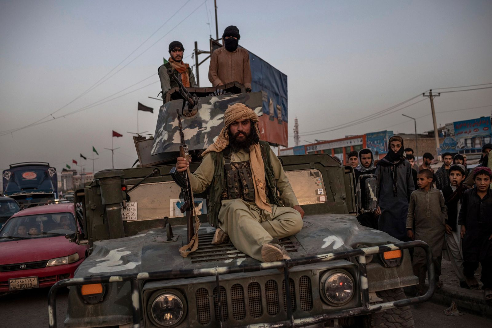 Taliban fighters on a Humvee in Kabul, Afghanistan, Aug. 15, 2021. (Jim Huylebroek/The New York Times)