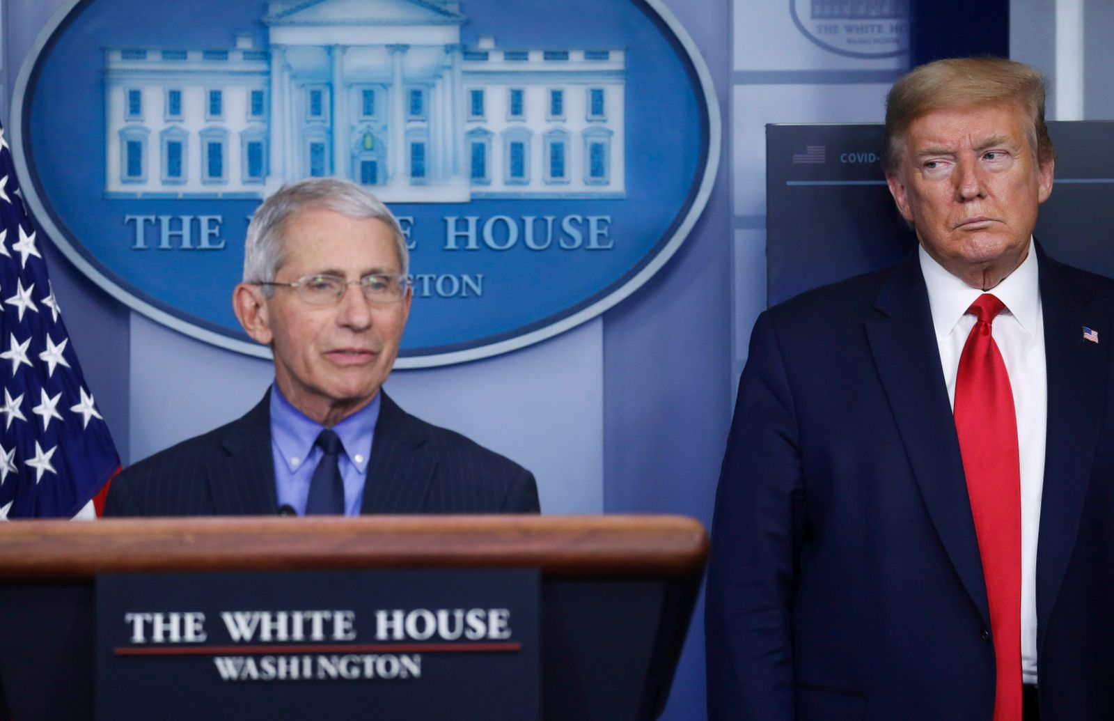 President Trump looks at Dr. Anthony Fauci as Fauci addresses the daily coronavirus response briefing at the White House in Washington