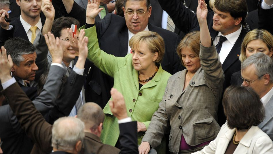 Chancellor Angela Merkel votes for the euro rescue deal on Friday.