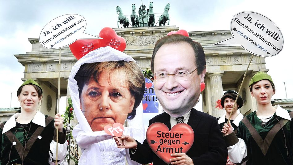 Demonstrators stage a mock wedding in Berlin on May 7th at Berlin's Brandenburg Gate: Never before have new German-French relations been as strained.