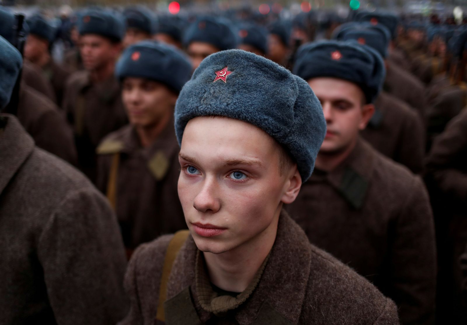 Russian Army member, dressed in historical uniform, looks on before a rehearsal for a military parade to mark the anniversary of a historical parade in 1941, when Soviet soldiers marched towards the front lines, at the Red Square in Moscow