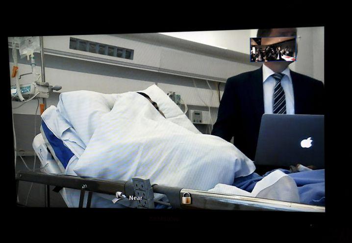 Videoschalte aus dem Krankenhaus in den Gerichtssaal