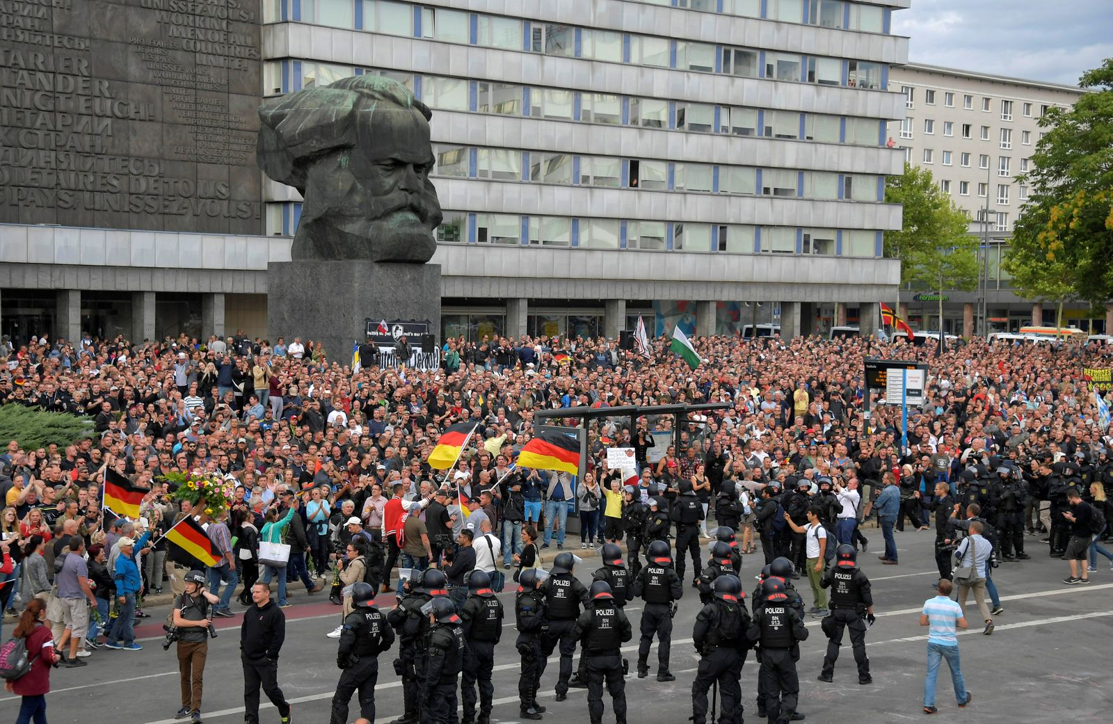 Right-wing supporters protest against foreigners after a German man was stabbed last weekend in Chemnitz