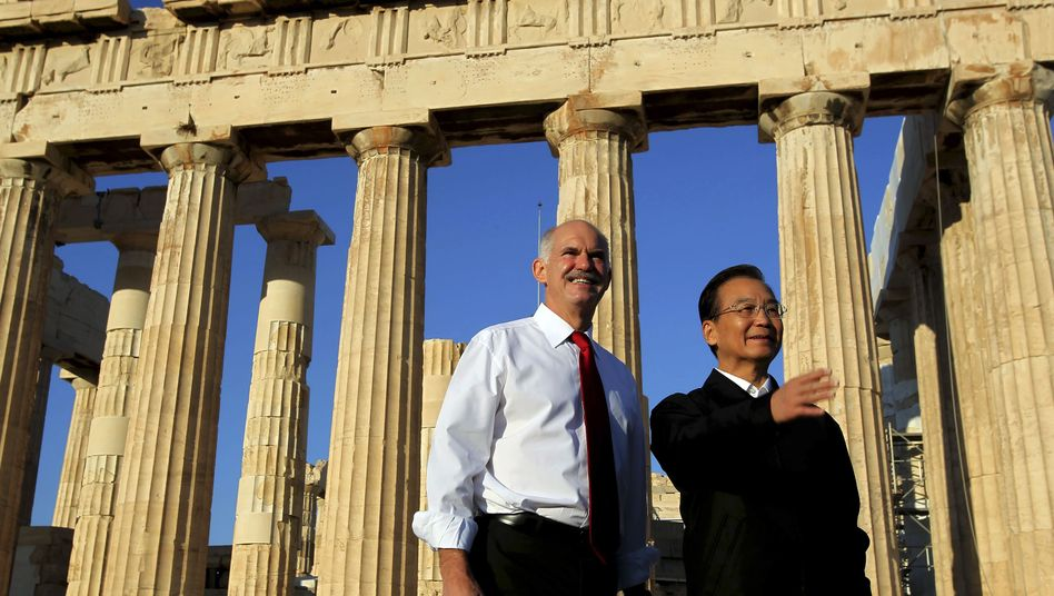 Former Greek Prime Minister George Papandreou with his Chinese counterpart Wen Jiabao in front of the Parthenon temple in Athens on Oct. 3.