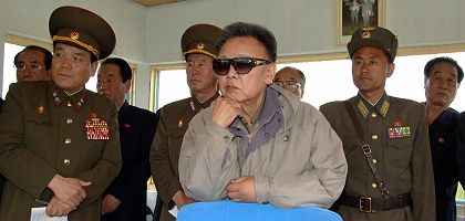 North Korean leader Kim Jong Il (center, front) visits an air force unit at an undisclosed location in North Korea.
