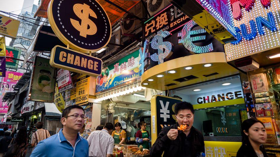 Wechselstube in Hongkong: Ein Währungskrieg hätte für Verbraucher fatale Folgen