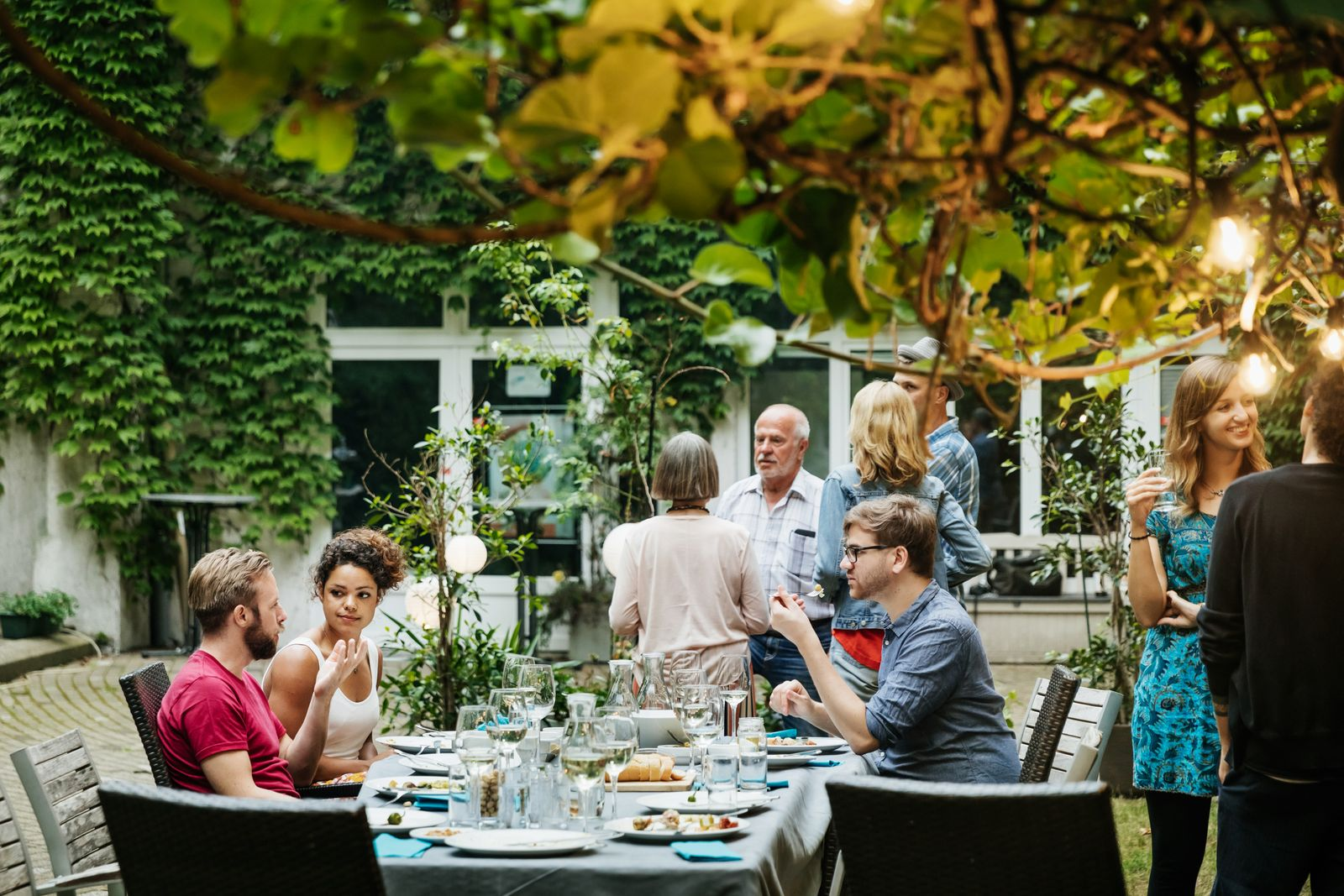 Family Eating together In Courtyard