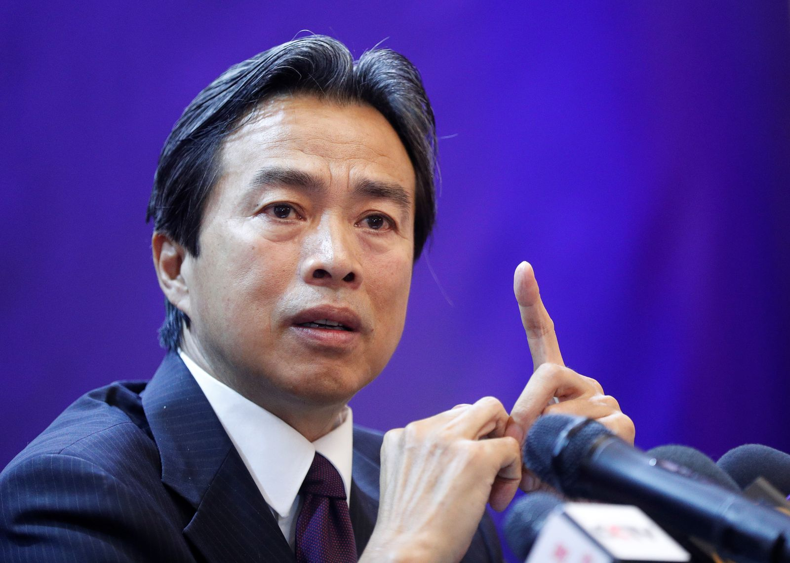 China's Ambassador to Ukraine Du Wei attends a news briefing in Kiev