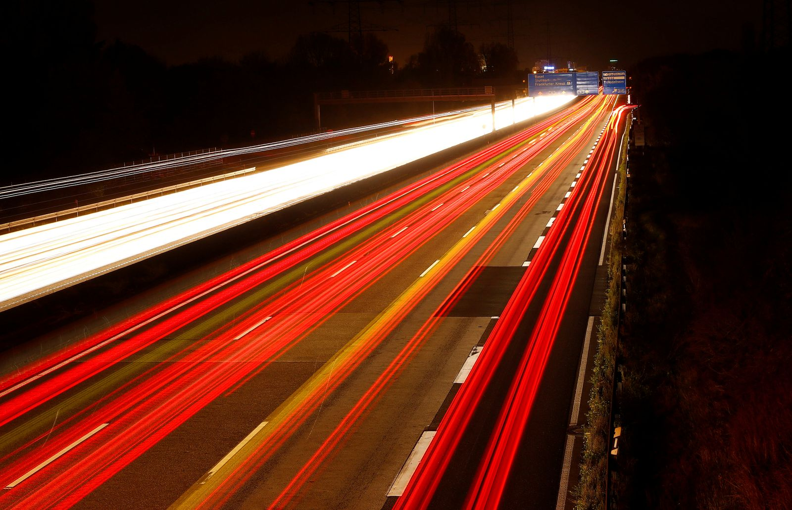 Cars are pictured on long time exposure on highway A5 in Frankfurt