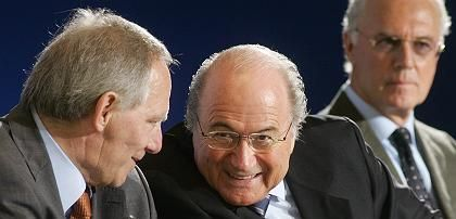 German Interior Minister Wolfgang Schäuble, left,talks to FIFA President Sepp Blatter of Switzerland as German soccer legend Franz Beckenbauer looks on during a security planning conference for the World Cup 2006 in Berlin.