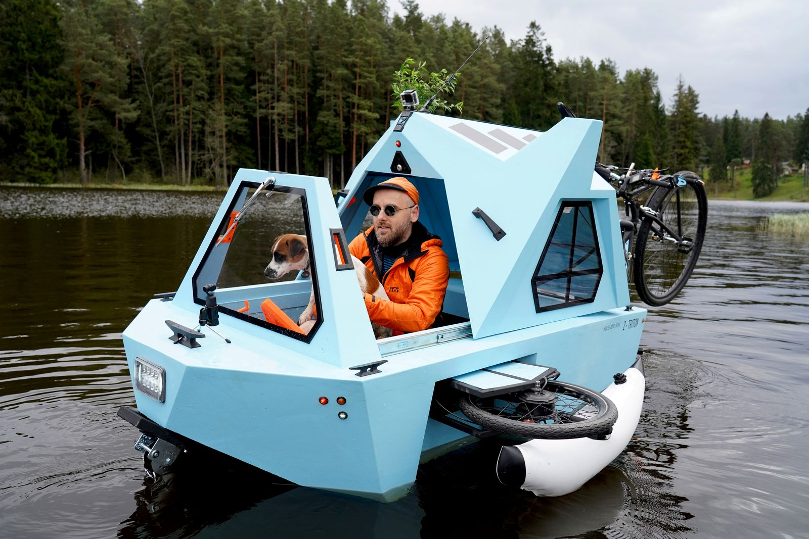 Designer Lauzis boats Z-Triton, a tricycle, a boat and a little house in one, in Smiltene