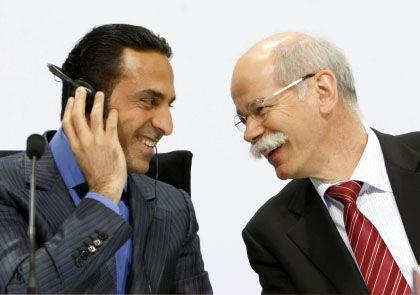 New buddies: Aabar Chairman Khadem Al Qubaisi (L) and Daimler CEO Dieter Zetsche.