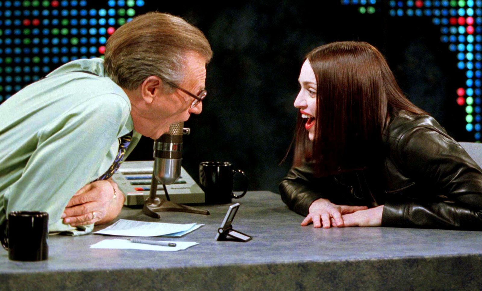 "FILE PHOTO: Singer and actress Madonna (R) shares a laugh with Larry King on the set of the CNN talk show ""Larry King Live\"