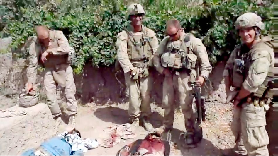 Video footage of four US Marines urinating on three dead Afghans circulated widely on the Internet this week.