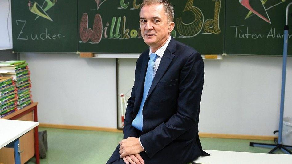 Minister Tullner