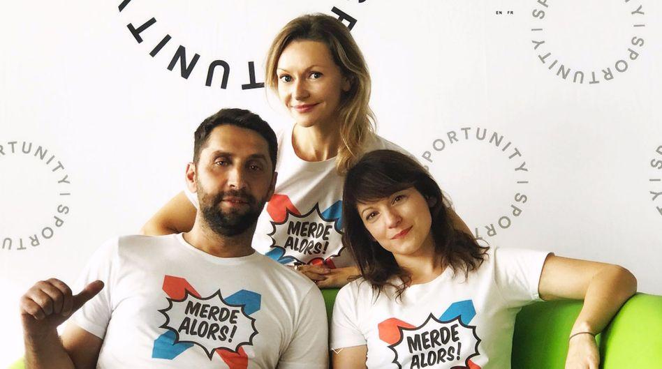 """Sportunity-Mitarbeiter Eryn Alexandrova, Agron Hyseni und DeeDee Ostrowska-Abdulhusein: """"Scheiße nochmal"""" als """"Symbol für ein offenes und humanes Europa"""""""