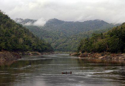 An ethnic Karen man crossing the Salween River from Myanmar into Thailand.