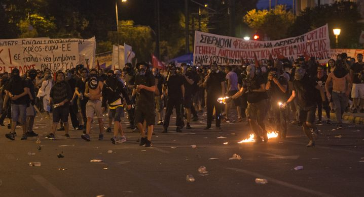 Demonstrators protest against new austerity measures in Athens' Syntagma Square on Wednesday.