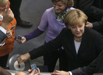 German Chancellor Angela Merkel casts her vote for the rescue package last Friday.