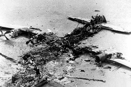 The scorched wreckage of an American C-130 Cargo aircraft involved in the failed August 1980 attempt to rescue the hostages.