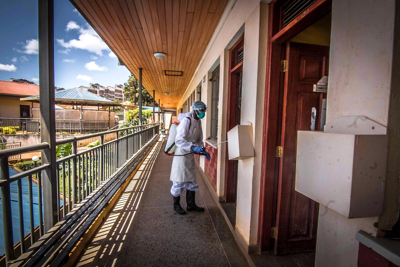April 11, 2020, Nairobi, Kenya: A local health official wearing a protective suit sprays disinfectant solution inside a