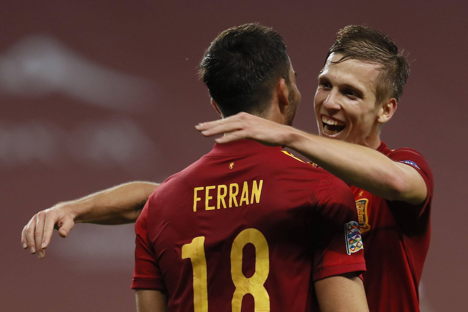 Spain s winger Ferran Torres (L) celebrates with his teammate Dani Olmo (R) after scoring the 5-0 during the UEFA Nation