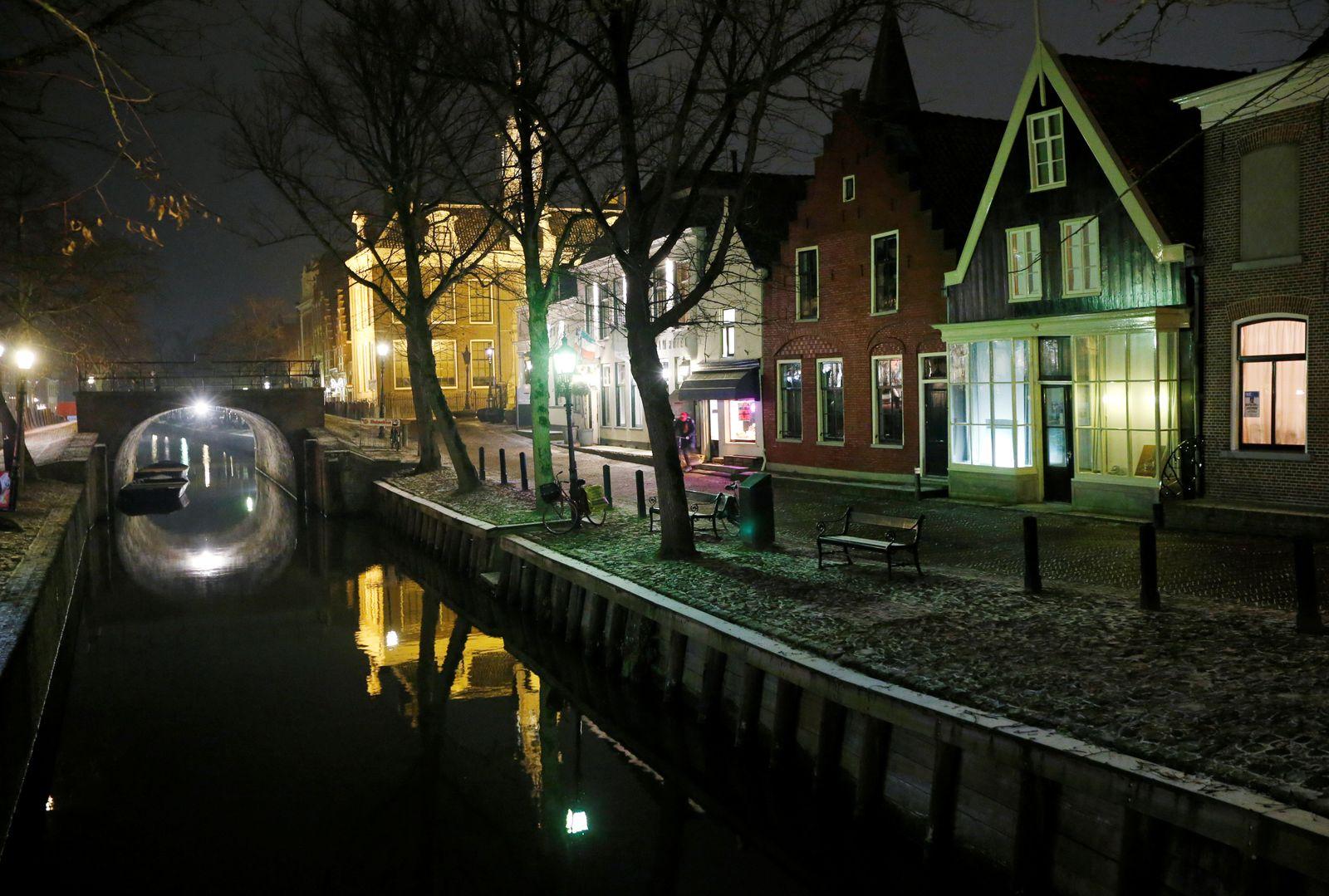 FILE PHOTO: View of a canal at night in Edam-Volendam near Amsterdam