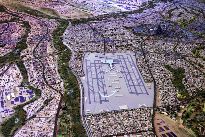The new Egyptian capital city, shown as a model here, would also be home an airport bigger than London's Heathrow.