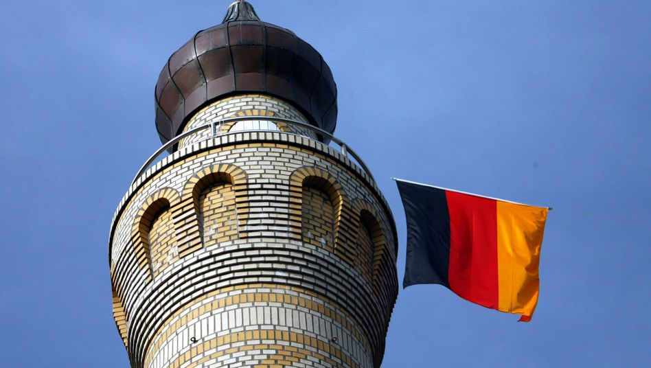"A minaret in the German town of Rendsburg: ""It is a mistake to look down on Muslims' religiosity."""