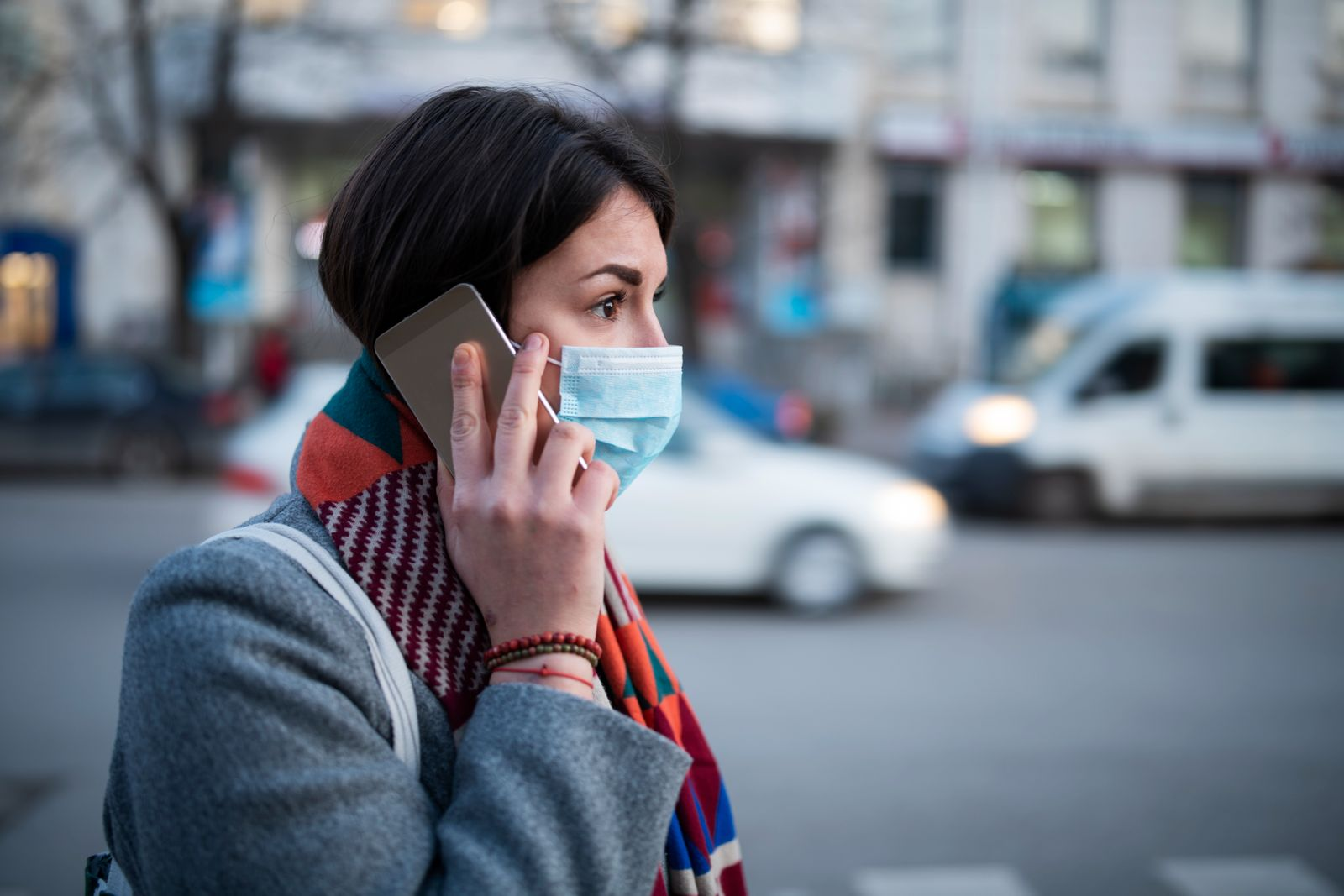 Young Woman With Face Mask Talking On The Phone.