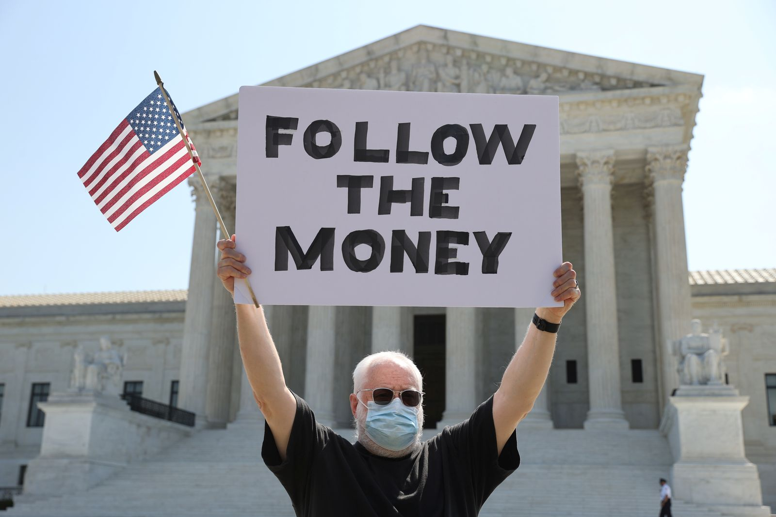 Demonstrator holds sign outside the U.S. Supreme Court in Washington