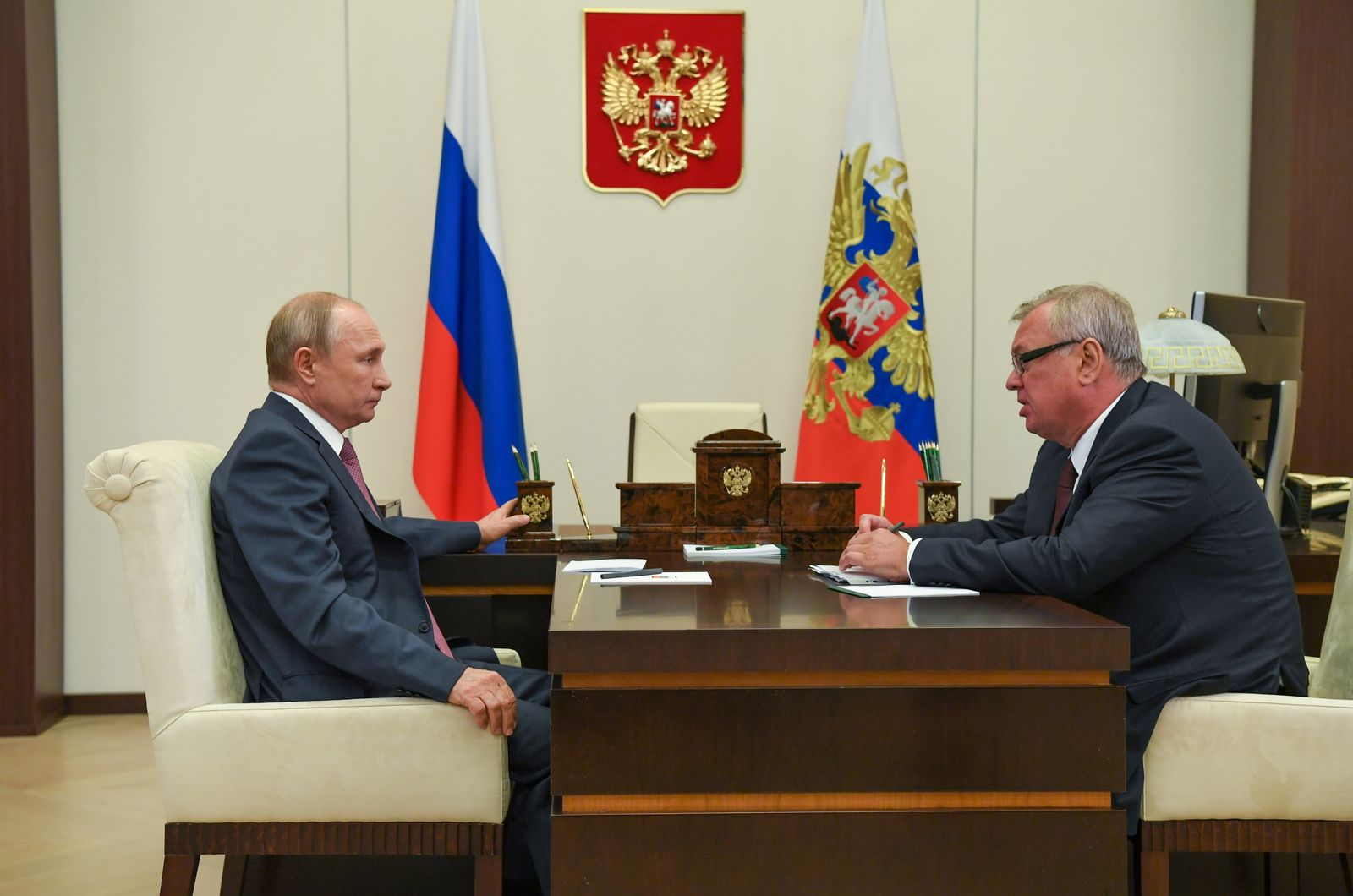 Russian President Putin attends a meeting with CEO of VTB bank Kostin outside Moscow
