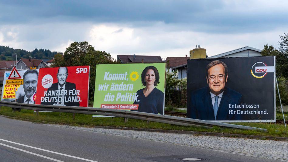 Wahlplakate mit Christian Lindner, Olaf Scholz, Annalena Baerbock und Armin Laschet: Offene Fragen aus Europa
