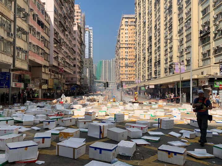 Protesters build barricades with white boxes: Demonstrators have begun occupying and holding ground in Hong Kong.