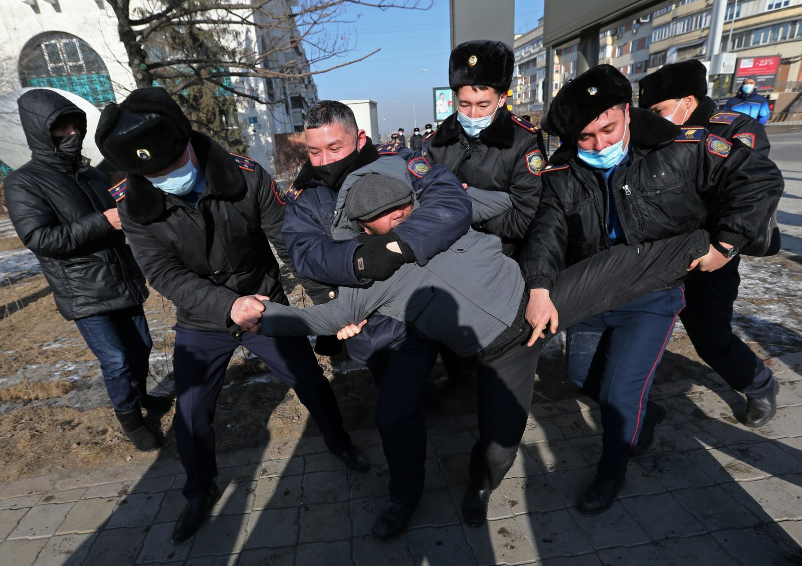 Kazakh opposition supporters hold a rally in Almaty