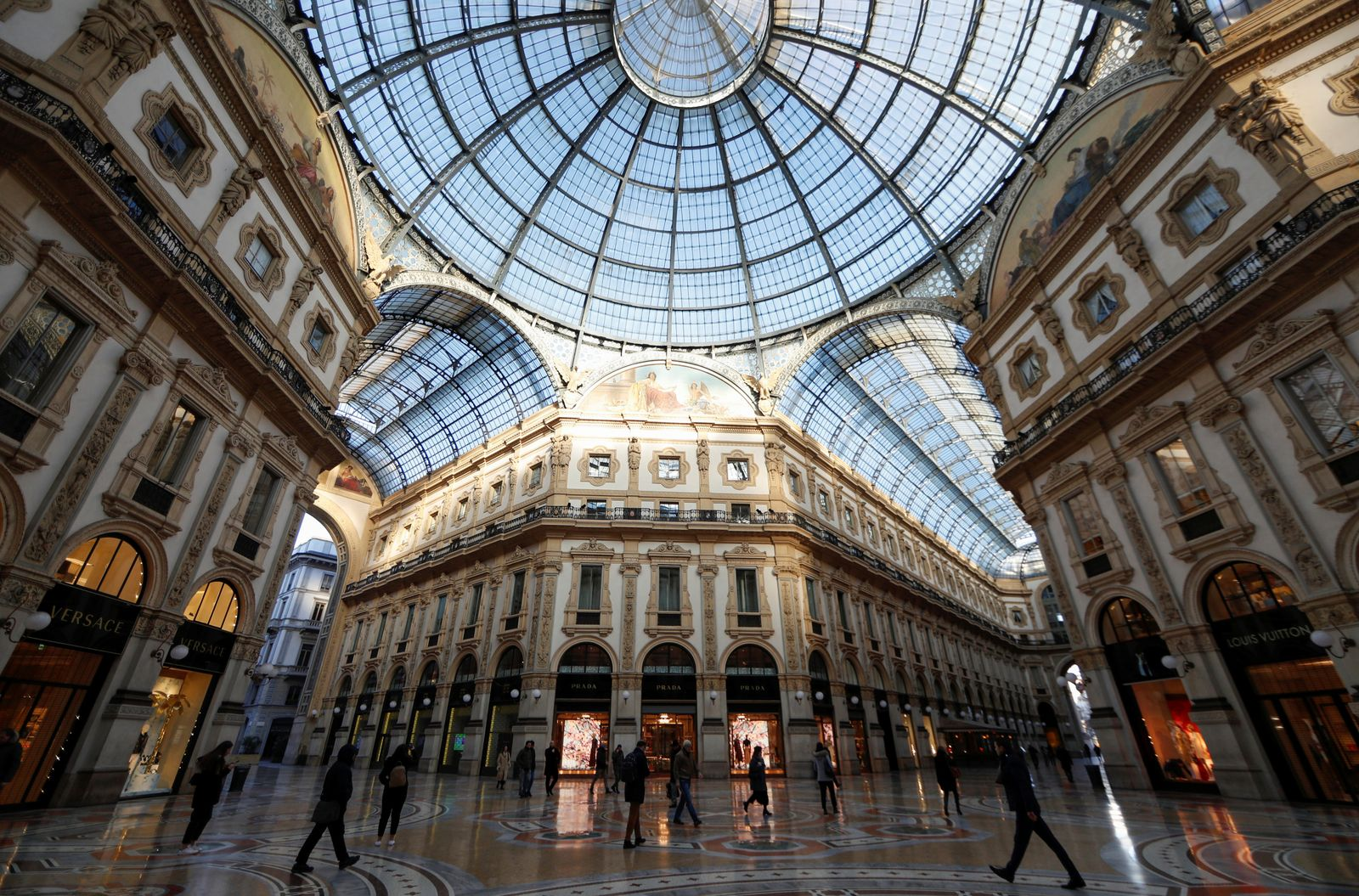 People walk along the Galleria Vittorio Emanuele II shopping mall, as a coronavirus outbreak in northern Italy continues to grow, in Milan