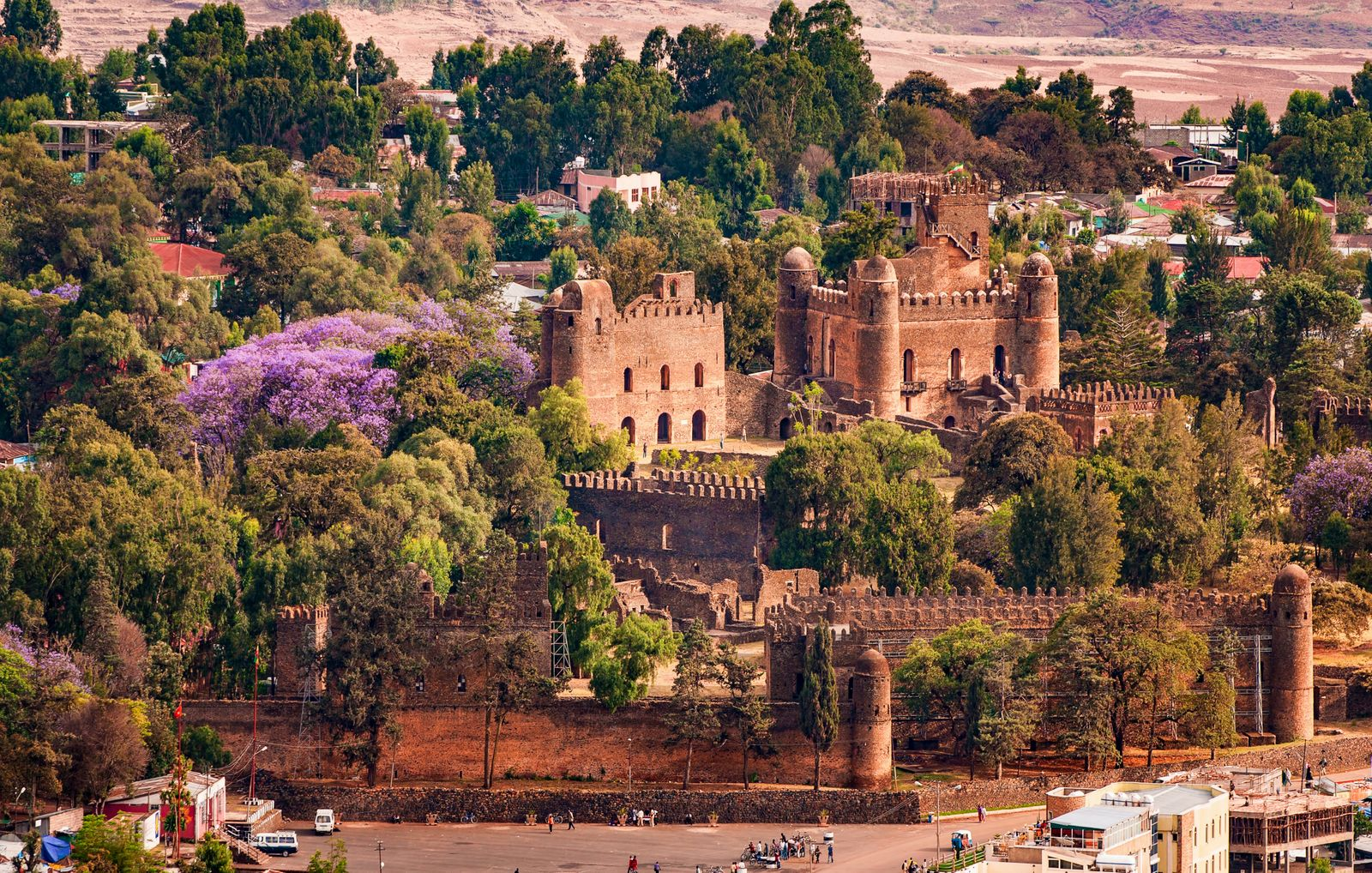 """500px Photo ID: 154495445 - Gondar previously served as the capital of the Ethiopian Empire. The city holds the remains of several royal castles, including those in Fasil Ghebbi (the Royal Enclosure), for which Gondar has been called the """"Camelot of Africa"""". King Fasil (Fasiledes) settled in Gondar and established it as a permanent capital in 1636. After Fasil, successive kings continued building, improving the techniques and architectural style. Before its decline in the late eighteenth century, the royal court had developed from a camp into a fortified compound called Fasil Ghebbi, consisting of six major building complexes surrounded by a wall 900 metres long. There are some twenty palaces and royal buildings and thirty churches in the area."""